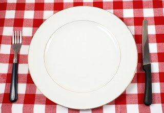 Dinner plate on red table cloth