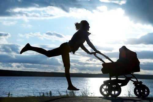 Woman working out with baby in stroller