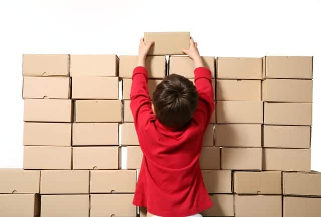 Boy stacking boxes
