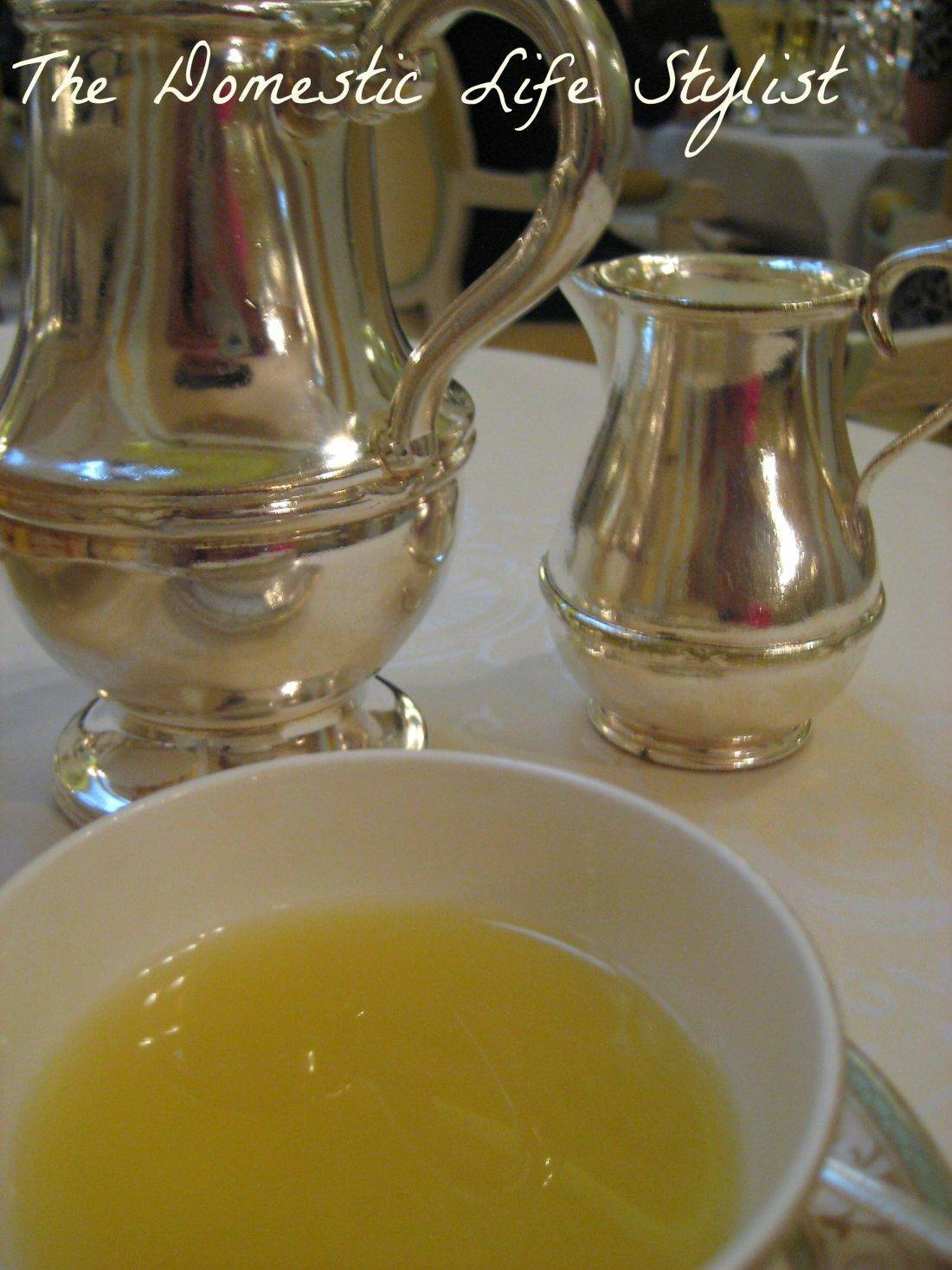 Cup of tea with silver tea pots
