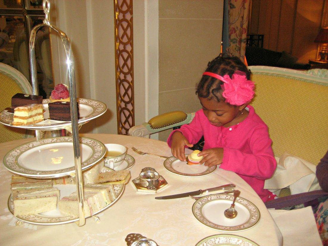 Toddler having afternoon tea