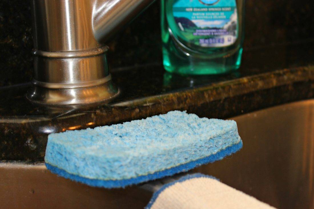 Blue sponge at kitchen sink