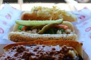 3 hotdogs on table