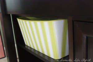 striped green basket for diapers