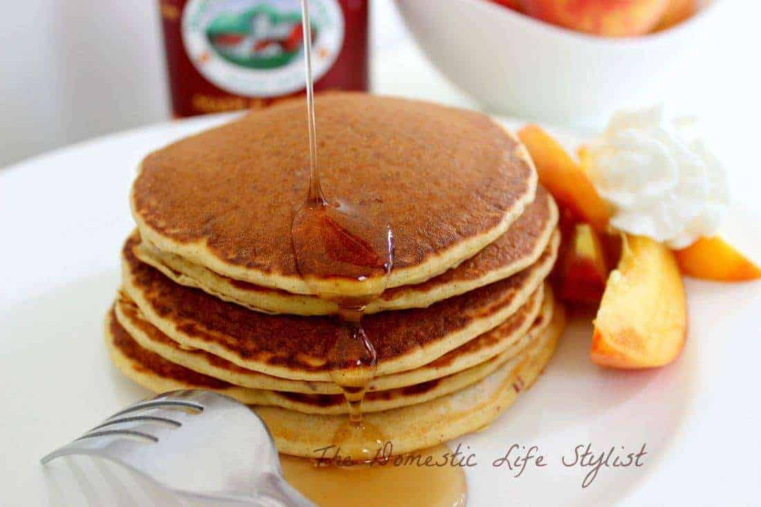 peaches and cream pancakes in white plate