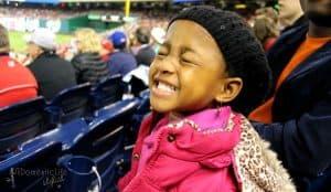 little girl at baseball game