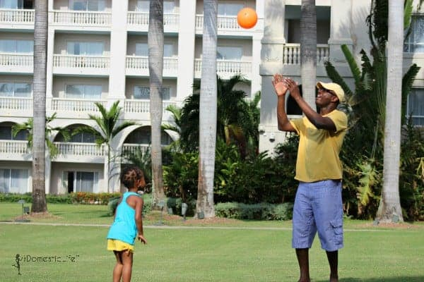 daddy and daughter playing ball