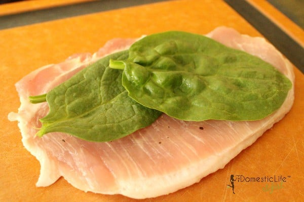 raw pork chop with spinach