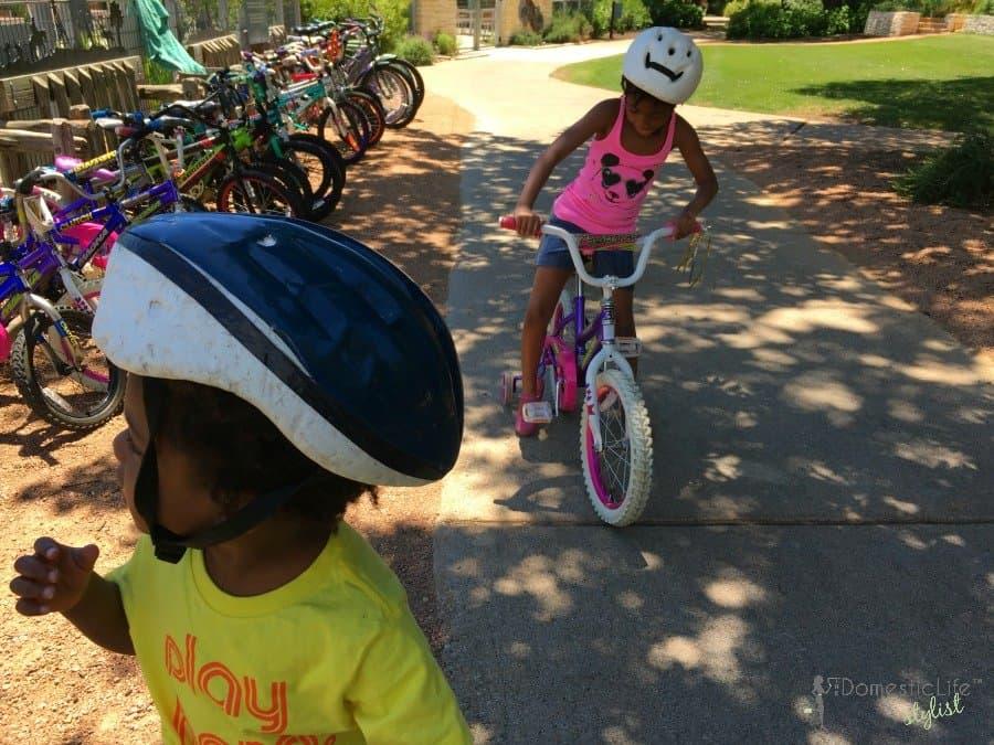 kids on bikes at resort