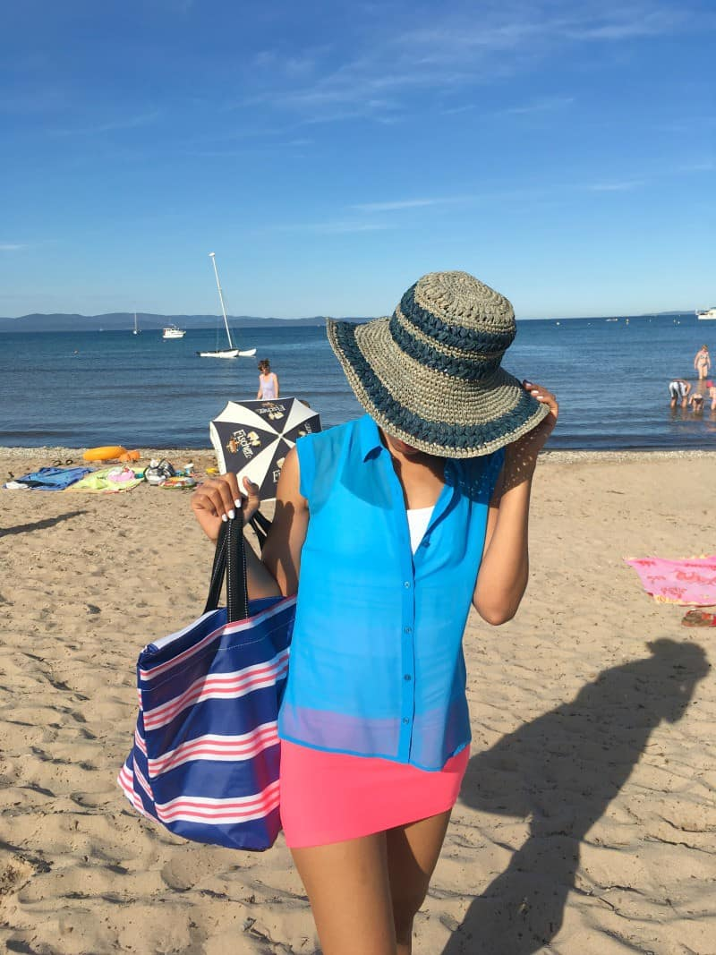 sunhat and scout bag on beach in french riviera