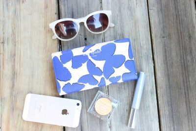 kate spade wallet along with sunglasses for spring