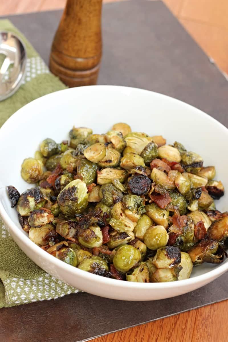 Roasted brussels sprouts with smokey bacon. This side won't last at your next holiday gathering. Naturally gluten free and dairy free.
