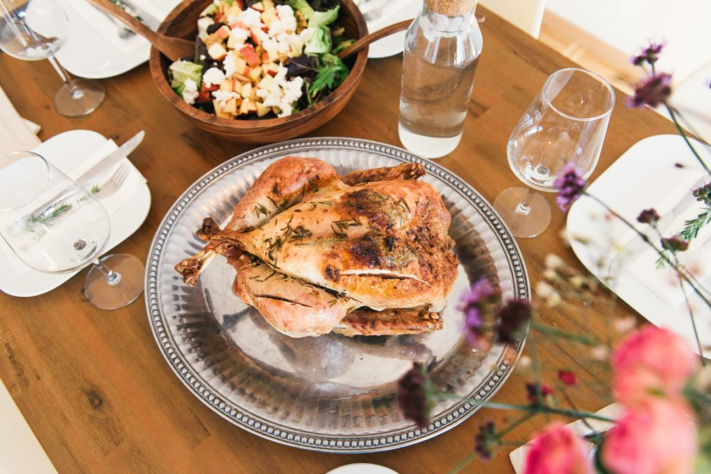 picture of healthy thanksgiving turkey on wooden table set for thanksgiving