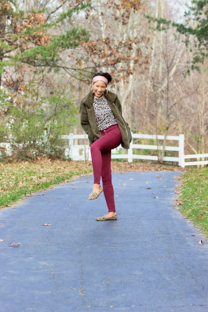 Stylish mom wearing fall outfit. Leopard print top, marron jeggings and oversized great jacket