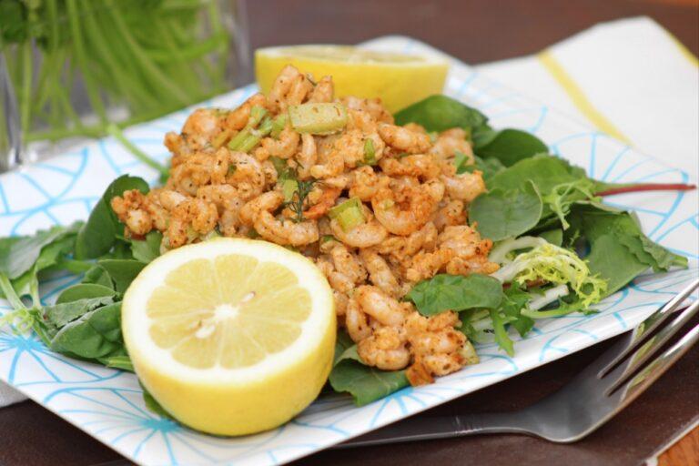 plate of zesty shrimp salad on a plate with lemon